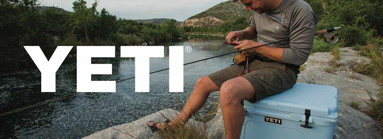 Shop YETI with logo with person fishing on YETI cooler